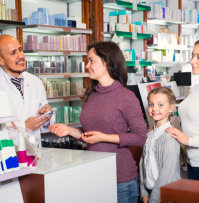 a pharmacist helping some customers
