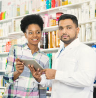 a customer smiling to a pharmacist holding a note