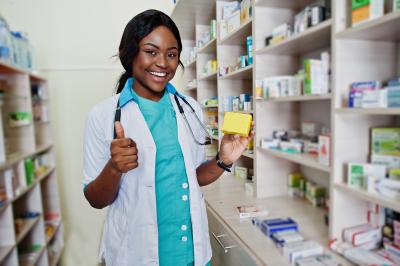 african american pharmacist working in a pharmacy.