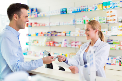 pharmacist and a client at a pharmacy, smiling