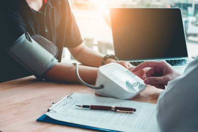 doctor measuring arterial blood pressure of a patient